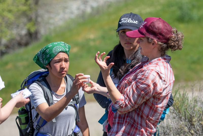 Maupin (at right) teaching spider sampling methods to BIOL 130 students in the field. Photo by Adam Green